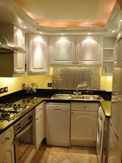 Fully equipped kitchen, including dishwasher, washing machine & microwave.