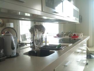 A smart, fully equipped kitchen, cooking while looking at the sea