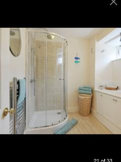The spacious and airy bathroom with underfloor heating.