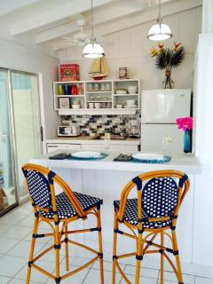 All new kitchen with Pottery Barn stools and maritime accents, like scrimshaw knobs.