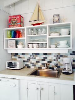 New appliances, dishware, cookware - nice glass tile back splash.