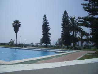 10 linea playa,1 dormitori, planta baja. piscina pista de tenis y minigolf