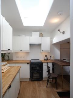 Light and airy, clean and well equipped kitchen retains an original cottage feel.