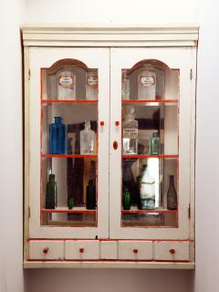 The cabinet contains essential oil bottles sourced in the local market.