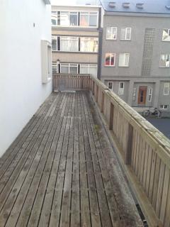 The apartment has a large balcony