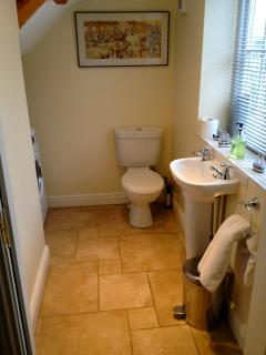 Down stair cloak room with washer/dryer