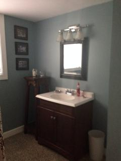 Hall bath located between the two bedrooms for added privacy.