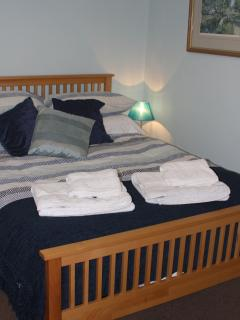 Comfortable double bed and walk in wardrobe.
