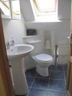 The bathroom with overbath shower
