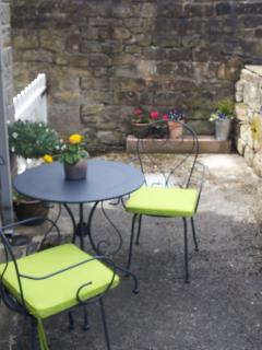 Enjoy a cup of tea or glass of wine in the seating area to the side of the cottage.