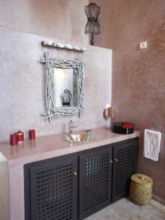 Italian walk-in shower bathroom with toilets on ground floor.