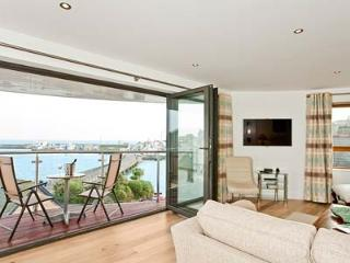 Bi fold doors opening onto balcony with stunning views over harbour