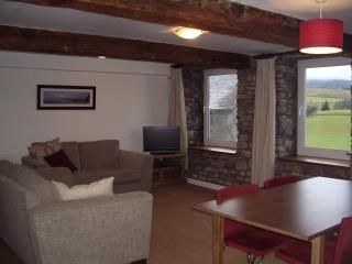 Spacious living area with great views, original stone walls and beams from historic ships
