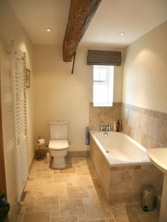 Family bathroom with bath and shower