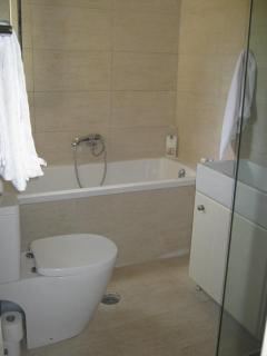 a bath   you will be happy in  with hand shower ..allso  seperate shower... .towels provided