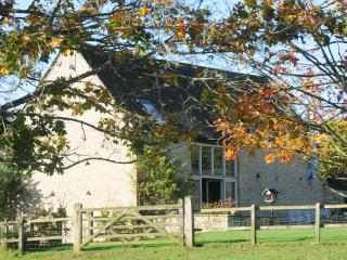 Heath Barn from the pony field with autumn colours.