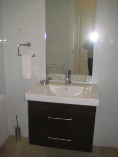 Modern en-suite bathroom which also has bath with shower over and toilet.