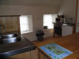 Fully equipped kitchen with fridge freezer, microwave
