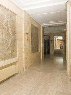 Marble stone walls and floors, the building is from 1937 and very well maintained.