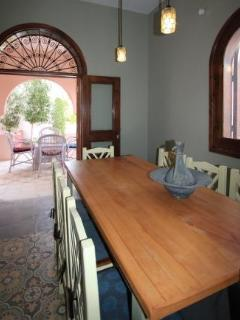Open plan dining area leading to terrace and garden in Villa Arabesque