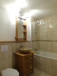 Bathroom with bath and shower screen, towel dry