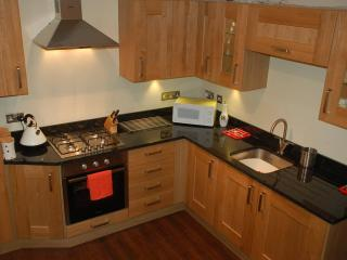 Newly fitted kitchen with granite worktop, integrated fridge/freezer, microwave, gas hob, fan oven.