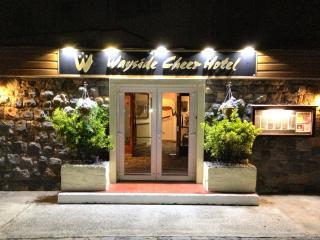 Wayside Cheer Hotel, Castel