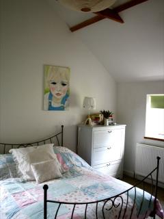 One of the beddrooms. Simply furnished and comfortable.