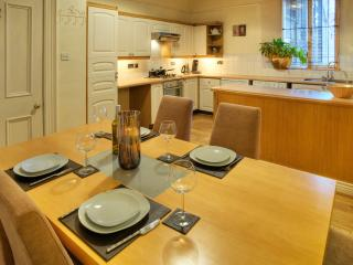 Fully fitted modern kitchen with dining area