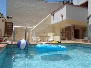 The pool area & the stairs leading to the 3rd Bedroom Balcony
