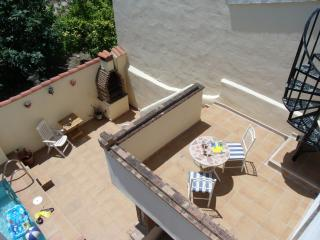 From the roof terrace looking down to the 3rd bedroom  balcony & pool area