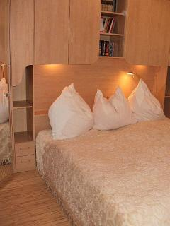 The bedroom offers comfortable sleeping space for two guests