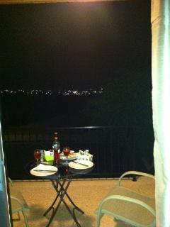 night time view over papohs bay from balcony