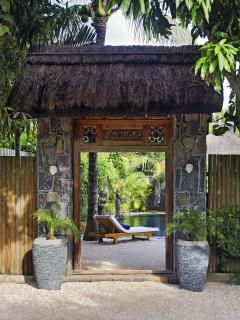 Our Javanese door between garden and private parking area