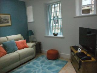 Sitting area. Large screen television and wi-fi.
