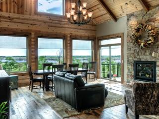 Great room to entertain with antique barn wood floors!
