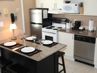 A fully equipped kitchen with stainless steel appliances and granite counters.