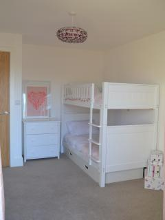 Spacious bunk room, with DVD Freeview TV, patio doors open to rear decking facing Swillbrook Lake.