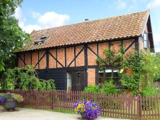 THE GRANARY, detached, 18th century cottage, exposed beams, woodburner, pet-frie
