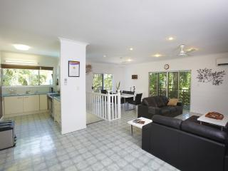 Upstairs open-plan living/dining/kitchen. Air-conditioned, ceiling fans. Screened doors & windows