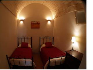 Twin bedded room on first floor with exposed stonework