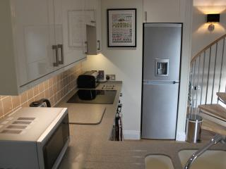 Modern kitchen with corian worktops, fridge freezer, oven,hob,microwave,dishwasher & washing mac