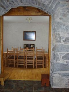 Looking from the kitchen to the dinning room which has a table large enough to seat 12 people