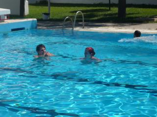 Cool down in the village pool in summer