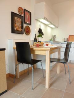 Dining area with extendable table and seating provided for up to 4