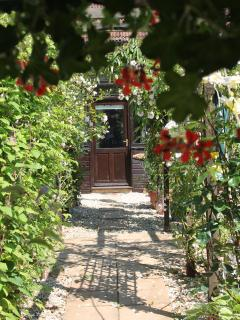 Baileys Barn front door seen through the pergola