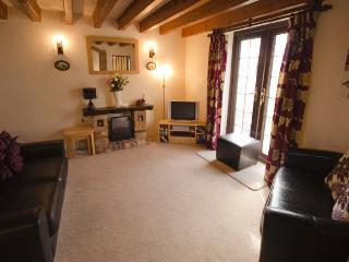 Sitting room with french doors to patio and sunny garden.  Ideal BBQ suppers.