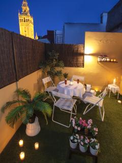 TERRACE BY NIGHT. Beautiful views to the Giralda, touristic icon of Seville.
