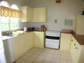 Large spacious kitchen with washer etc. overlooking front garden.