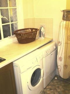 Utility room- washing machine, tumble drier, sink, ironing board and iron